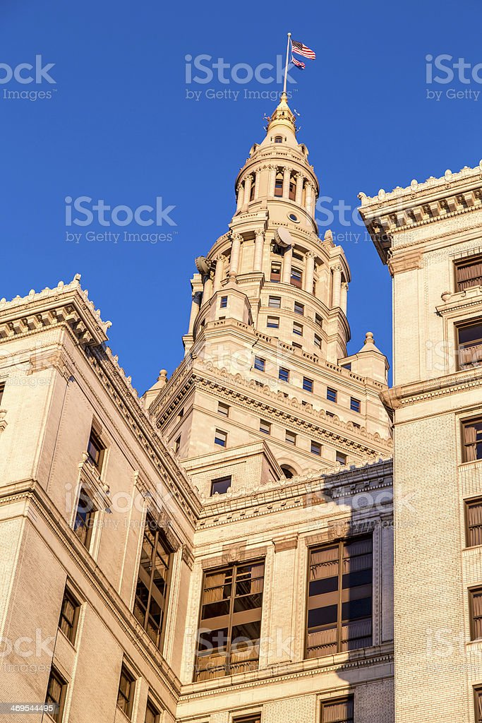 tall stone and brick building with flag on top stock photo