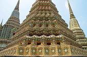 Bangkok, Thailand - March 23, 2019: High decorated stupas (chedis) in one of main temples in Bangkok.