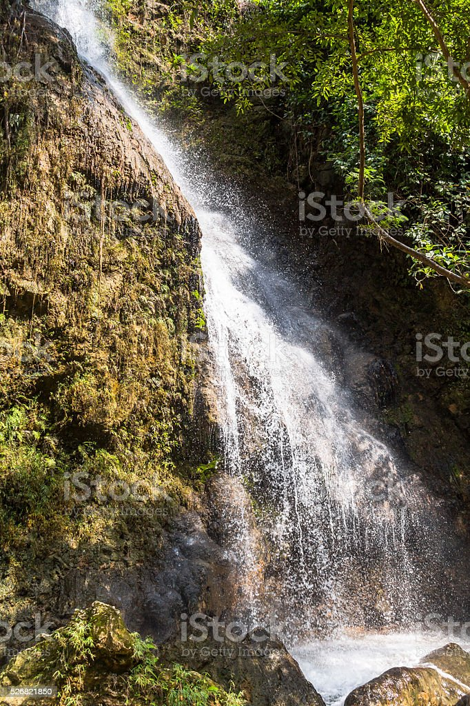 Tall waterfall floating inside water pool, Indonesia stock photo
