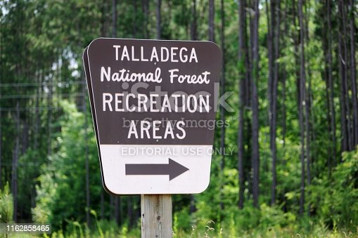 Heflin, Alabama, USA - June 15, 2019: Close up of sign for the Talladega National Forest Recreation Areas.  Located along highway 78 near Heflin, Alabama.