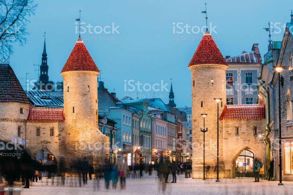 Tallinn, Estonia. Famous Landmark Viru Gate In Street Lighting At Evening Or Night Illumination. Christmas, Xmas, New Year Holiday Vacation In Old Town. Popular Touristic Place stock photo