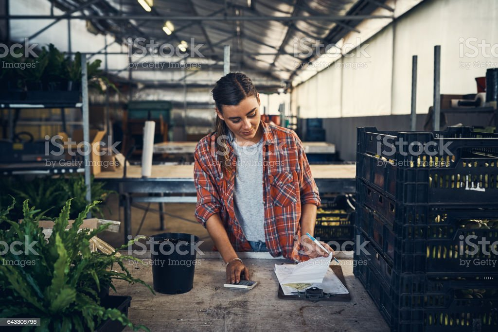 Tallying up the sales for the day stock photo