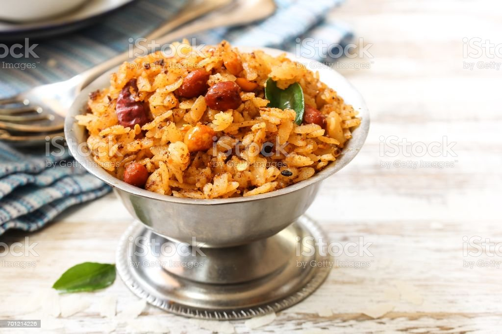 Tamarind Poha / Puli Aval - South Indian breakfast with flattened rice, selective focus stock photo