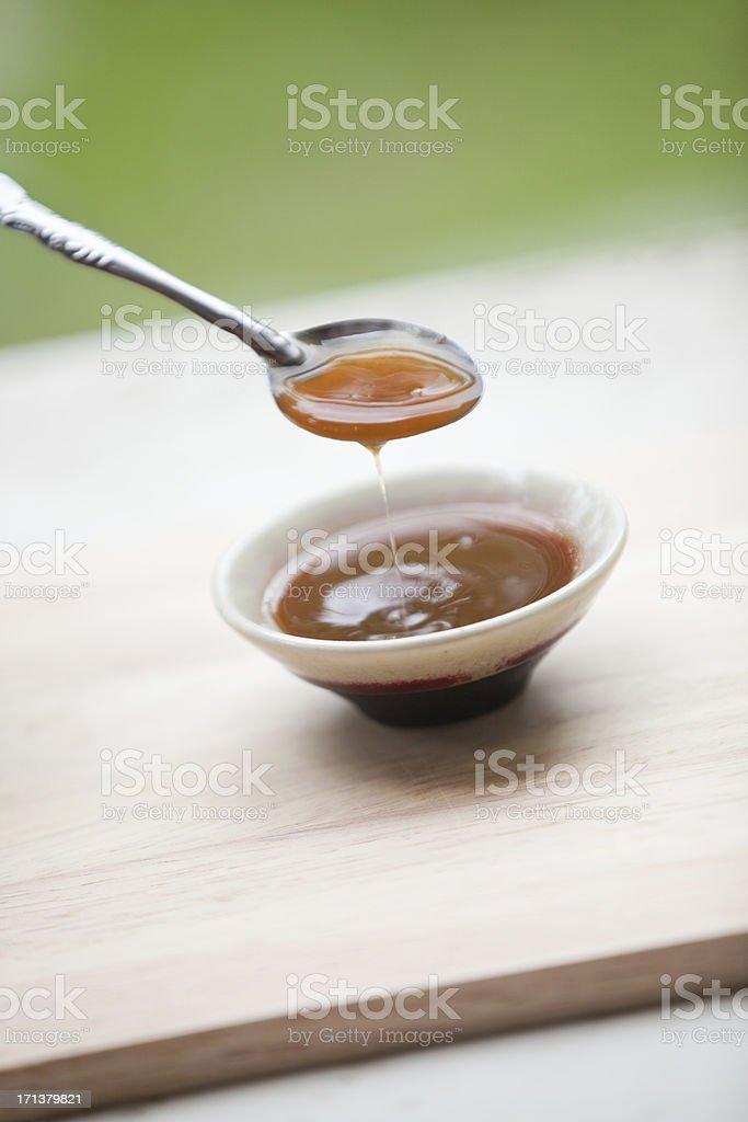 Tamarind Sauce, paste, juice, liquid in mini bowl. stock photo