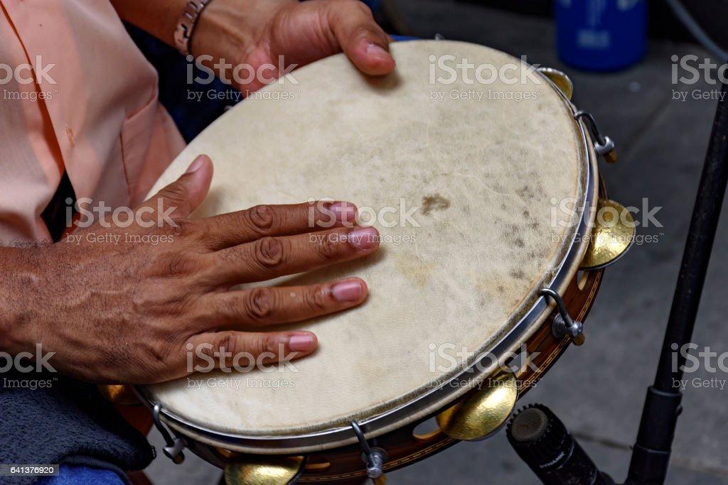 Tambourine player stock photo