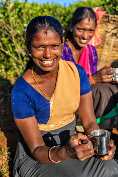 Royalty free tamil pictures images and stock photos istock tamil women drinking fresh tea on plantation ceylon stock photo thecheapjerseys Gallery