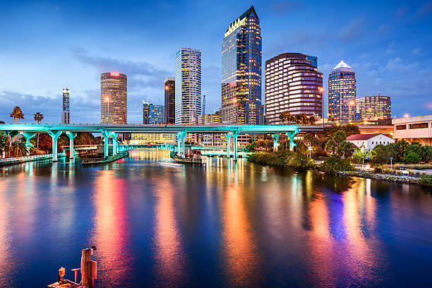 Tampa, Florida Skyline Tampa, Florida, USA downtown city skyline over the Hillsborough River. downtown district stock pictures, royalty-free photos & images