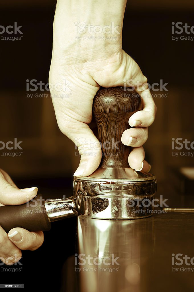 Tamping Coffee for Cappuccino royalty-free stock photo