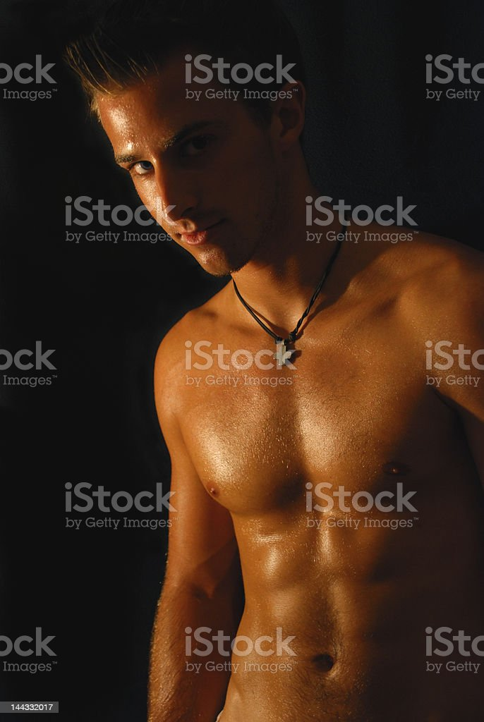 Tan athletic shirtless male looking at you royalty-free stock photo