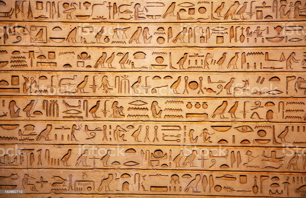 A tan background of old Egyptian hieroglyphics stock photo