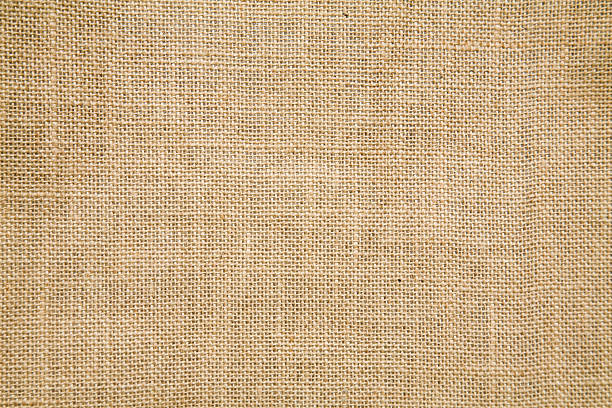 A tan burlap textile background can you be used for a sack stock photo