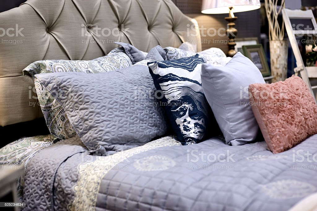 Tan Colored Decorative Pillows on a  Store Shelf stock photo