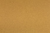 istock Tan, gold, yellow, beige paper close-up. Texture in extremely high resolution. 1220747696