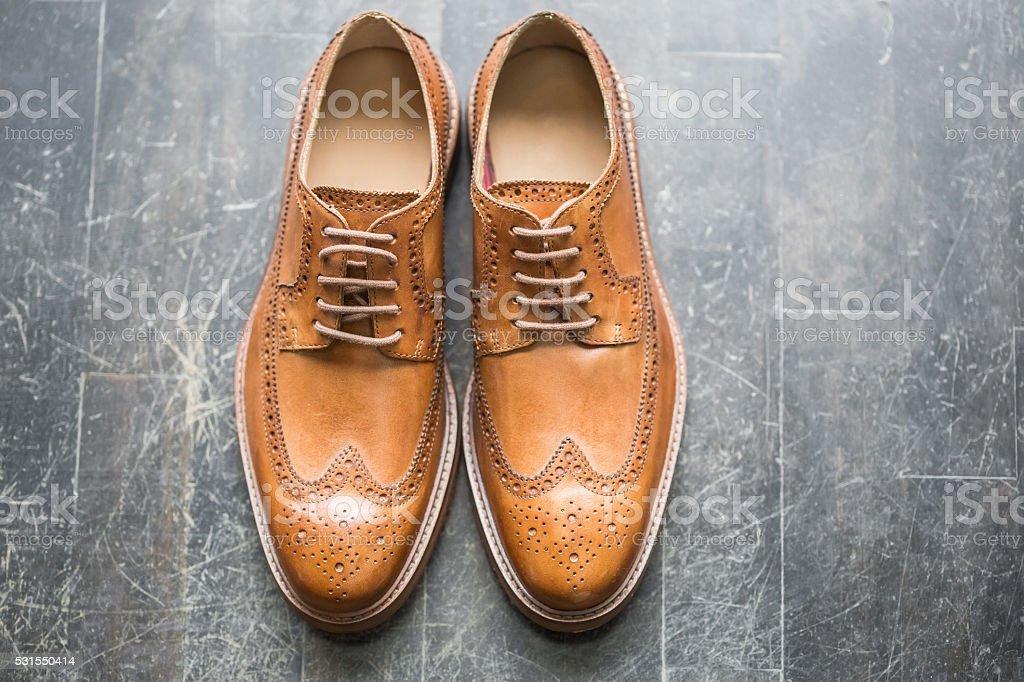 Tan Italian leather brogues stock photo