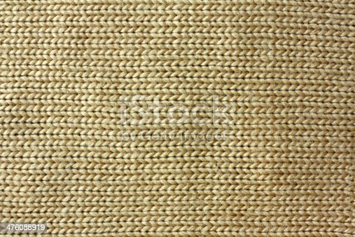 istock Tan Knitted Tweed Fabric Background 476088919