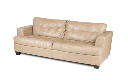 Tan leather sofa isolated on white.