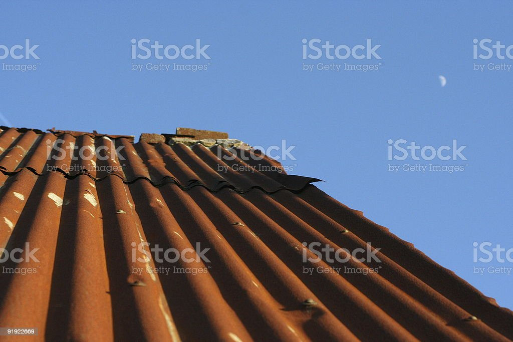 Tan Red Roof Against a Blue Sky royalty-free stock photo