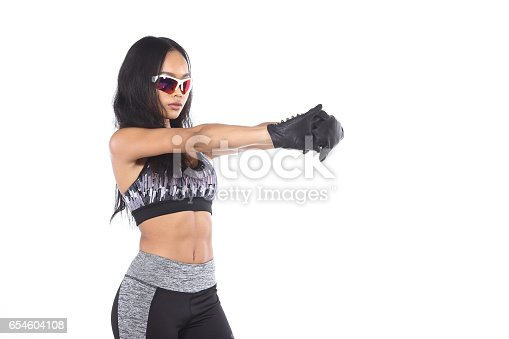 607622628istockphoto Tan Skin Asian Fitness Girl Exercise boxing warm up 654604108