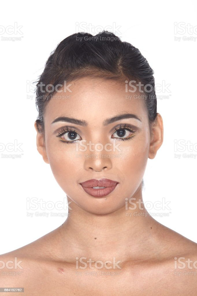 Tan Skin Asian Woman after make up. no retouch, fresh face with acne foto stock royalty-free