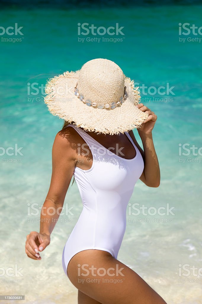 tan woman on beach royalty-free stock photo