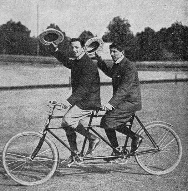 Tandem bikers stock photo