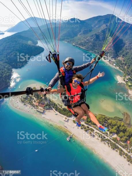 Tandem jump in paragliding picture id1141688597?b=1&k=6&m=1141688597&s=612x612&h=pac4dvdqdubjgkvtxkutprlh dnpqoegmn3nyb9hphk=
