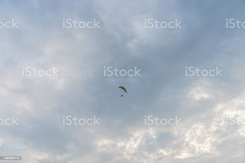 Tandem Motor Paraglider Flying High In The Evening Cloudy