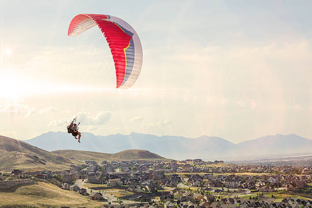 Tandem Paraglide Couple Tandem Paraglide paragliding stock pictures, royalty-free photos & images