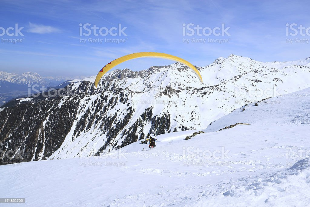 Tandem paraglider starts to fly royalty-free stock photo