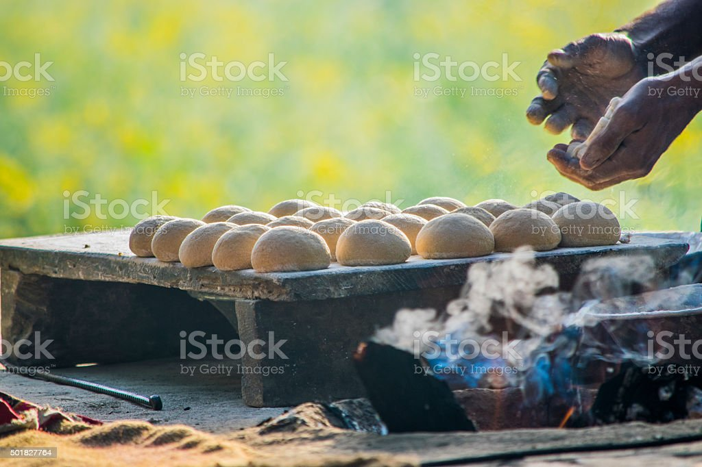 Tandoor in a village, Wheat bread making in a village stock photo