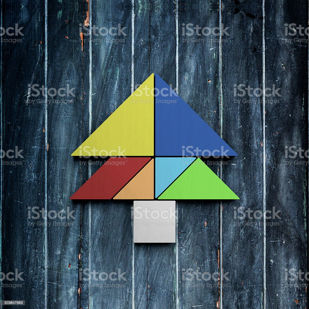 tangarm made christmas tree on isolated plank board background royalty free stock photo