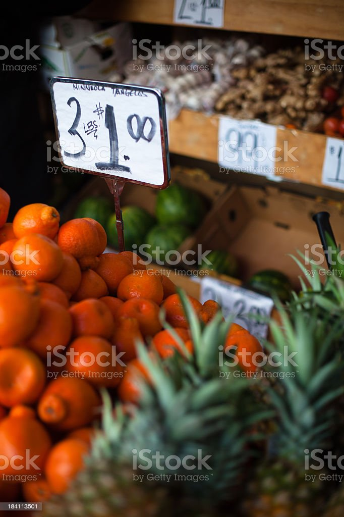 Tangelos and Pinapples for Sale royalty-free stock photo