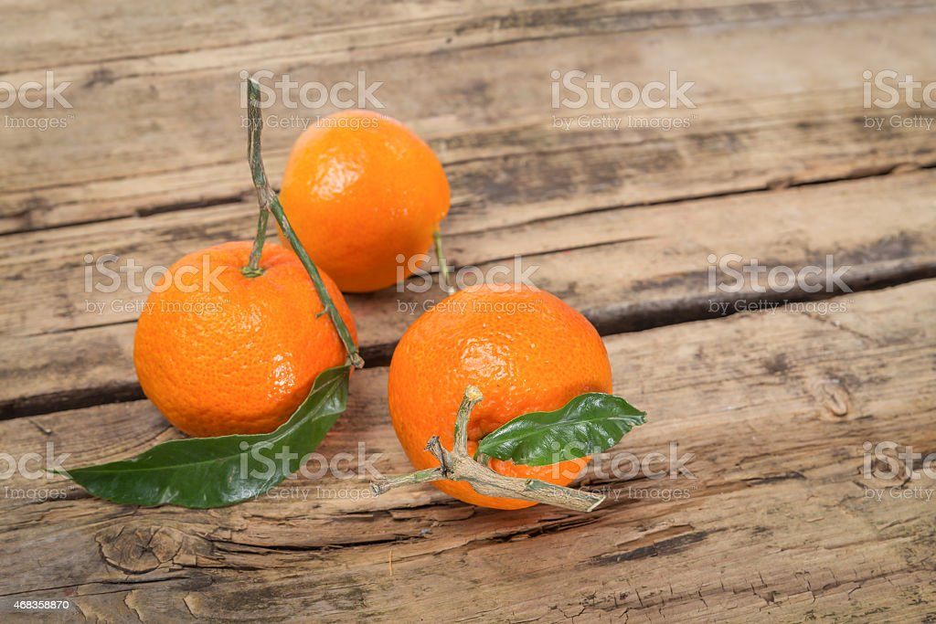 Tangerine fruits on wooden background royalty-free stock photo
