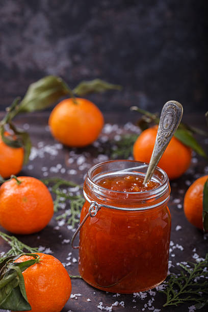 Tangerine jam in a glass jar stock photo