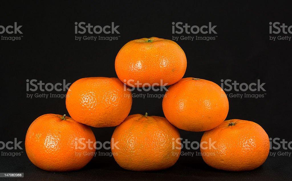 Tangerine pyramid stock photo
