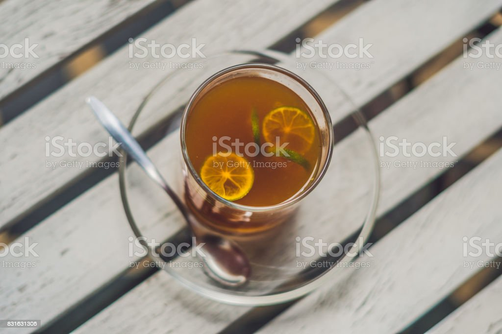 Tangerine tea on a table in a cafe stock photo