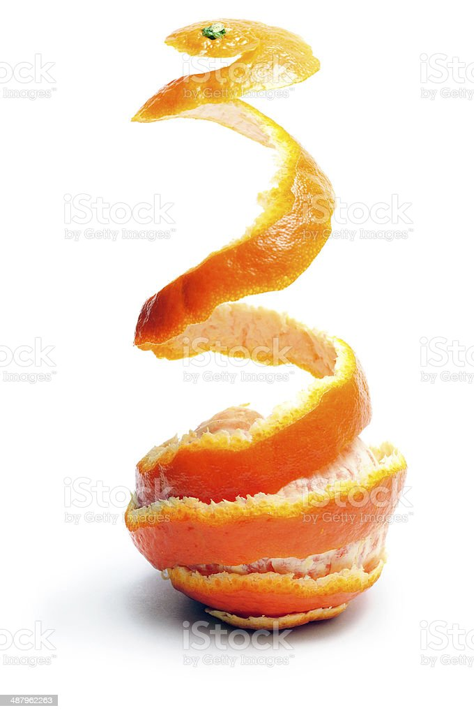 Tangerine with the taken off peel stock photo