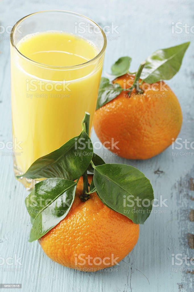 Tangerines and orange juice royalty-free stock photo