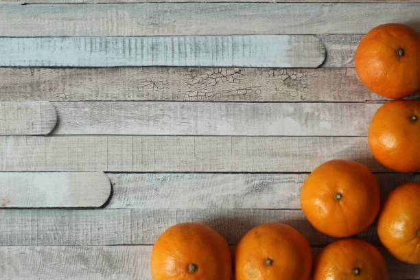 Tangerines on a wooden background stock photo