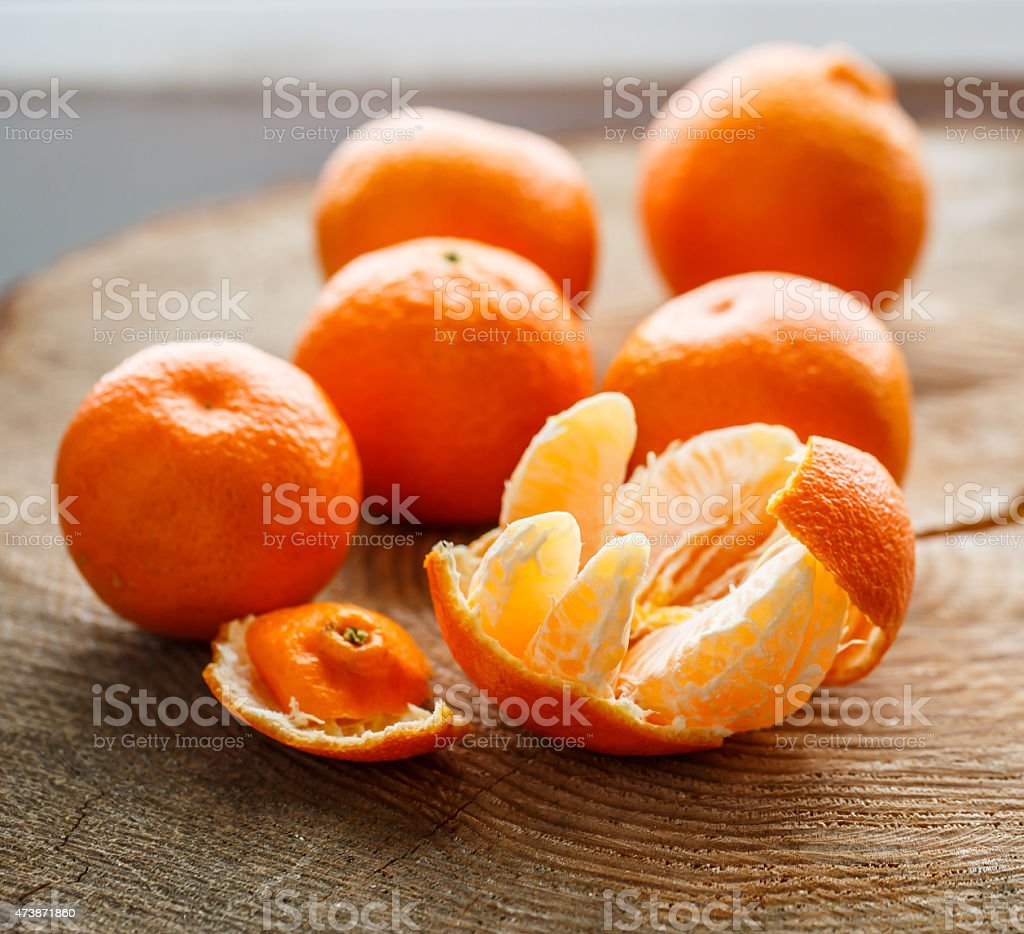 Tangerines on the wooden table stock photo