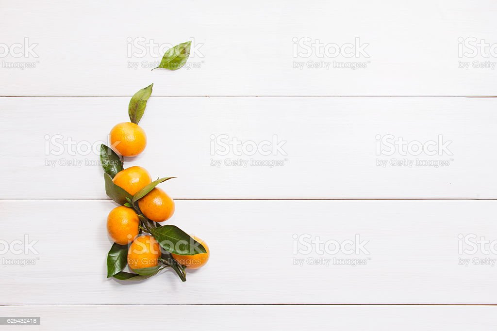Tangerines (mandarin) on white wooden background stock photo