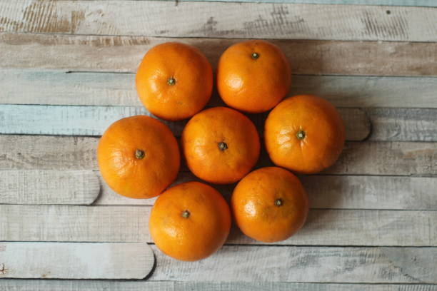 Tangerines on wooden background stock photo