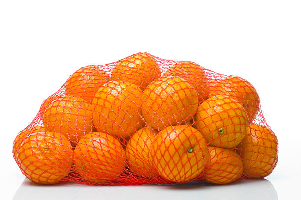 tangerines tangerines in net bag netting stock pictures, royalty-free photos & images