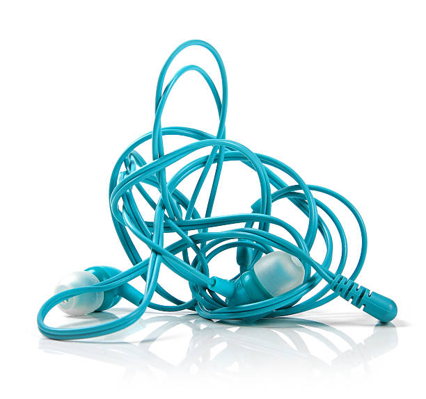 tangled earphones isolated on white - tangled stock photos and pictures