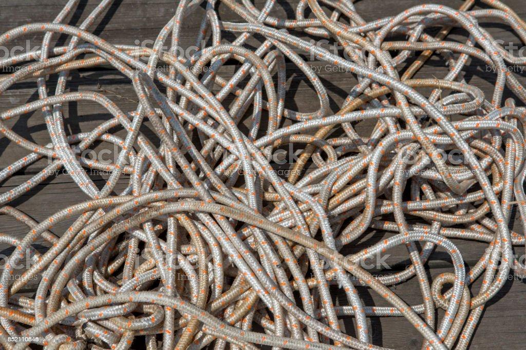 tangled lanyard ropes pile on wood platform deck at sapanca lake near izmit sakarya turkey stock photo