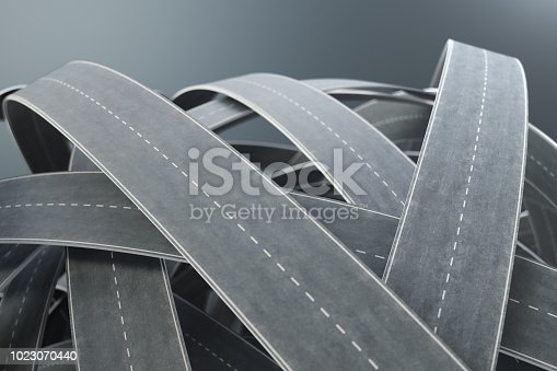 istock Tangled roads and highways in a chaotic. The concept of an intricate road that has no end and no beginning. Labyrinth of roads, traffic congestion. 3D illustration 1023070440