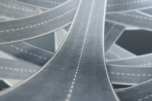 istock Tangled roads and highways in a chaotic. The concept of an intricate road that has no end and no beginning. Labyrinth of roads, traffic congestion. 3D illustration 1023070448