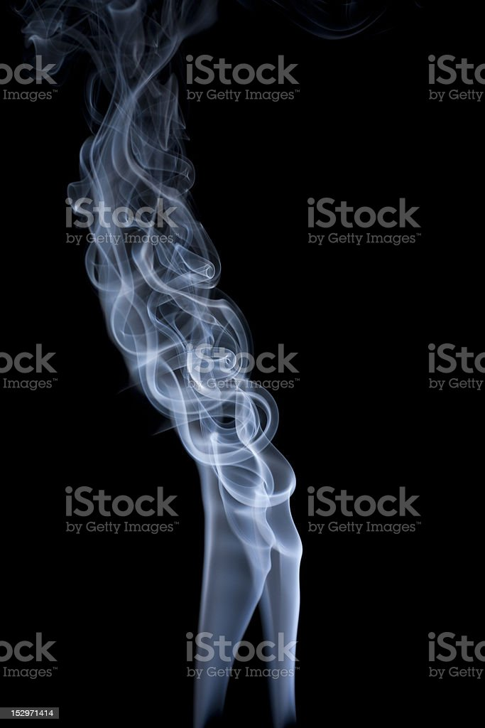 Tangled smoke from two sources on black stock photo