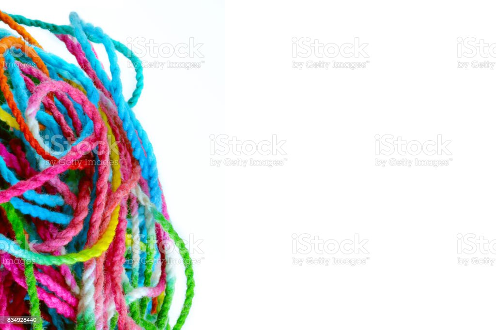 tangled yarn, tangled colorful sewing threads on white background with copy space. stock photo
