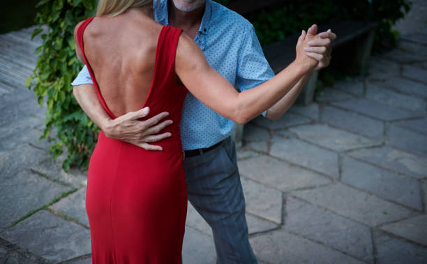 tango dance in the park stock photo